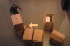 Mann mit Kisten